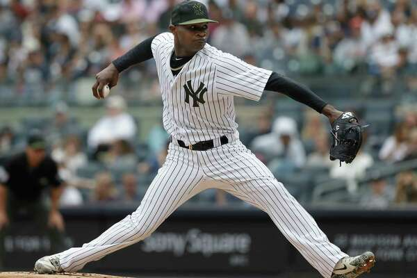 New York Yankees pitcher Domingo German throws during the first inning of the game against the Houston Astros at Yankee Stadium Monday, May 28, 2018 in New York. (AP Photo/Seth Wenig)
