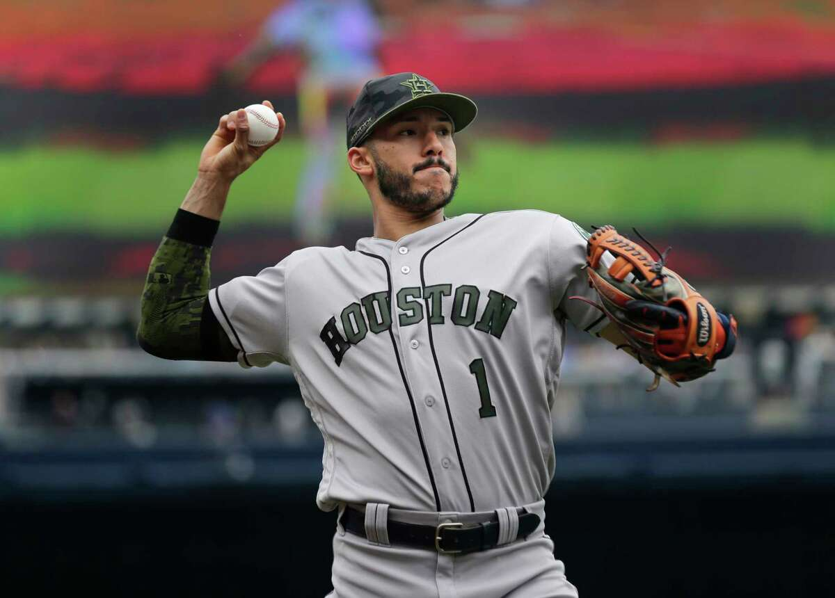 Houston Astros' Carlos Correa warms-up before the first inning of the game against the New York Yankees at Yankee Stadium Monday, May 28, 2018 in New York. (AP Photo/Seth Wenig)