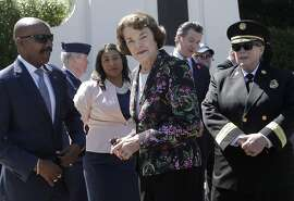Kenneth C. Johnson of the National Cemetery Administration, from left, stands with San Francisco mayoral candidate and Board of Supervisors President London Breed, Sen. Dianne Feinstein, D-Calif., California Lt. Gov. Gavin Newsom and San Francisco Fire Chief Joanne Hayes-White at a Memorial Day Commemoration at San Francisco National Cemetery in the Presidio in San Francisco, Monday, May 28, 2018. (AP Photo/Jeff Chiu)