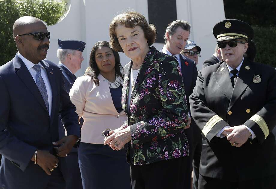 Kenneth C. Johnson of the National Cemetery Administration, from left, stands with San Francisco mayoral candidate and Board of Supervisors President London Breed, Sen. Dianne Feinstein, D-Calif., California Lt. Gov. Gavin Newsom and San Francisco Fire Chief Joanne Hayes-White at a Memorial Day Commemoration at San Francisco National Cemetery in the Presidio in San Francisco, Monday, May 28, 2018. (AP Photo/Jeff Chiu) Photo: Jeff Chiu, Associated Press