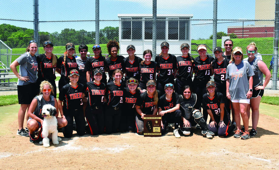 The Edwardsville softball team poses with the Class 4A Alton Regional championship plaque after defeating Springfield Sacred Heart-Griffin on Saturday.
