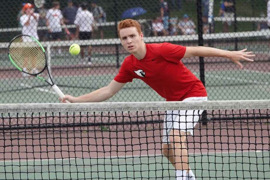 Greenwich senior Nick Dagnino hits a volley during his doubles match at the Class LL tournament on Saturday. Photo: Contributed Photo