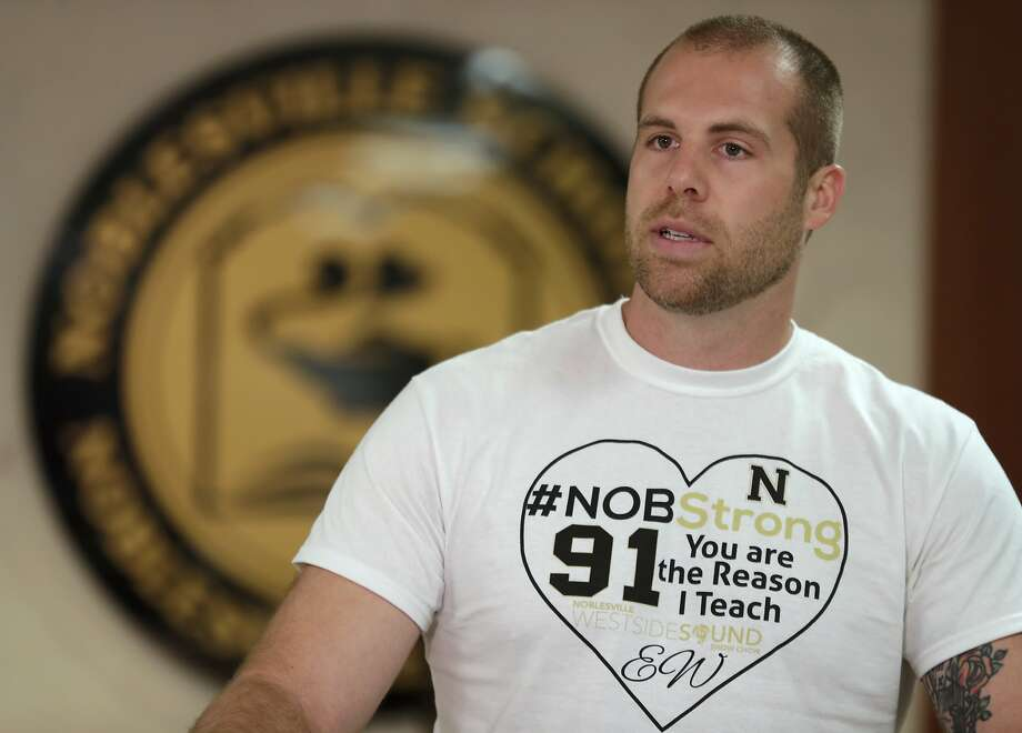 Jason Seaman, a seventh grade science teacher at Noblesville West Middle School in Noblesville, Ind., speaks during a news conference Monday, May 28, 2018. Seaman tackled and disarmed a student with a gun at the school on Friday. He was shot but not seriously injured. (AP Photo/Michael Conroy) Photo: Michael Conroy, Associated Press