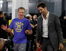 Warriors head coach Steve Kerr and General Manager Bob Myers chat while arriving before the Golden State Warriors played the Houston Rockets in Game 7 of the Western Conference Finals at the Toyota Center in Houston, Texas, on Monday, May 28, 2018.