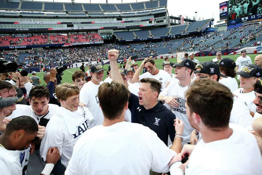 Yale coach Andy Shay celebrates with his team after defeating Duke 13-11 in the NCAA men's lacrosse championship at Gillette Stadium in Foxborough, Mass. Photo: Maddie Meyer / Getty Images / 2018 Getty Images