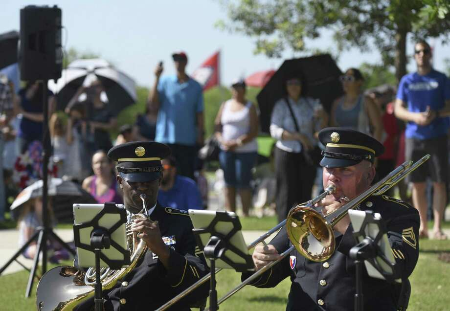 Members of Fort Sam Houston's 323rd Army Band play during the Memorial Day ceremony at Fort Sam Houston National Cemetery on Monday, May 28, 2018. Memorial Day is traditionally a day to honor those who have died in America's wars and those who served and have since died. Photo: Billy Calzada, Staff / San Antonio Express-News / San Antonio Express-News