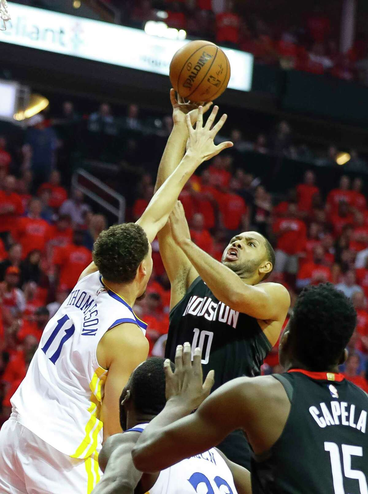 Houston Rockets guard Eric Gordon (10) shoots over Golden State Warriors guard Klay Thompson (11) during Game 7 of the NBA Western Conference Finals at Toyota Center on Monday, May 28, 2018, in Houston.