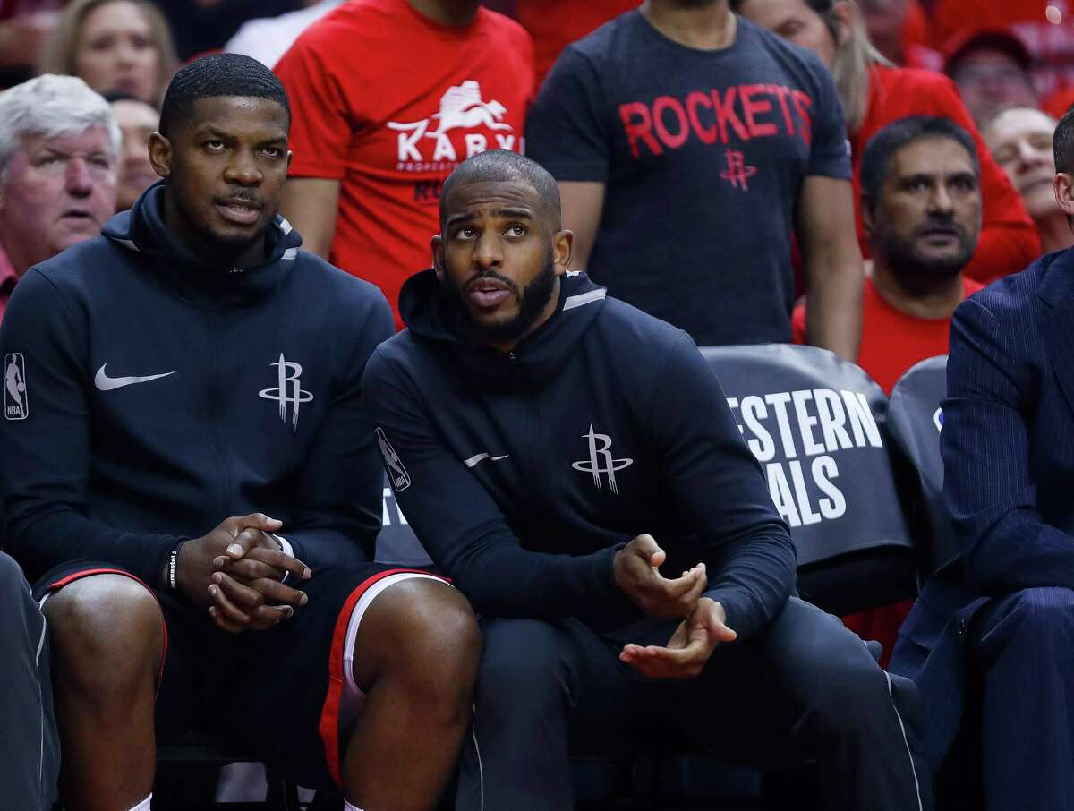 Houston Rockets guards Joe Johnson (7) and Chris Paul (3) chat on the bench during Game 7 of the NBA Western Conference Finals at Toyota Center on Monday, May 28, 2018, in Houston.