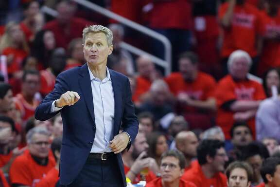 Golden State Warriors head coach Steve Kerr talks to his players during Game 7 of the NBA Western Conference Finals at Toyota Center on Monday, May 28, 2018, in Houston.