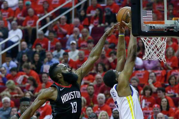 Houston Rockets guard James Harden (13) defends against Golden State Warriors forward Kevon Looney (5) during the first half of Game 7 of the NBA Western Conference Finals at Toytota Center, May 28, 2018, in Houston.