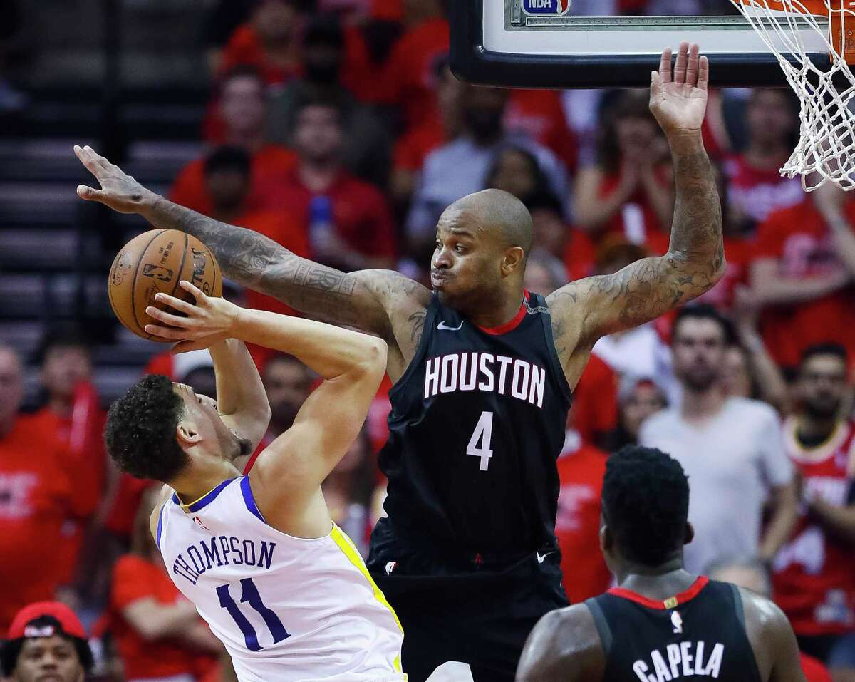 Golden State Warriors guard Klay Thompson (11) tries to shoot through Houston Rockets forward PJ Tucker (4) during Game 7 of the NBA Western Conference Finals at Toyota Center on Monday, May 28, 2018, in Houston.