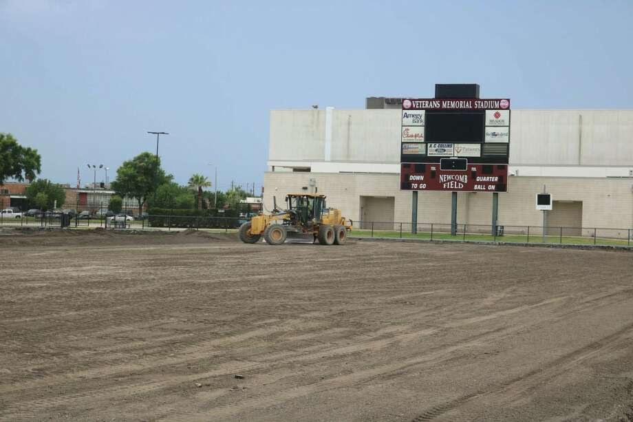 A grader smooths out dirt inside Veterans Memorial Stadium in preparation for the new artificial turf that will be installed in the weeks ahead. Also coming down this summer will be the scoreboard. Photo: Robert Avery
