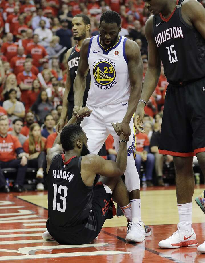 131906b717dc Golden State Warriors forward Draymond Green (23) helps Houston Rockets  guard James Harden (