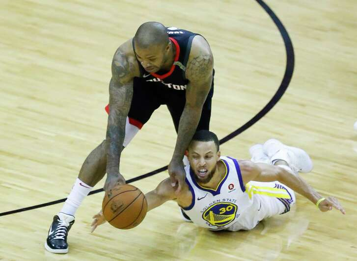 Houston Rockets forward PJ Tucker (4) and Golden State Warriors guard Stephen Curry (30) dive for a loose ball during the second half of Game 7 of an NBA Western Conference Finals at Toyota Center, May 28, 2018, in Houston.