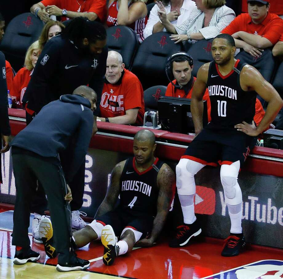 Rockets forward PJ Tucker (4) sits on the ground next to teammate Eric Gordon (10) while being consoled by the injured Chris Paul at the conclusion of Game 7 of an NBA Western Conference Finals on Monday night at Toyota Center. Photo: Karen Warren, Houston Chronicle / © 2018 Houston Chronicle