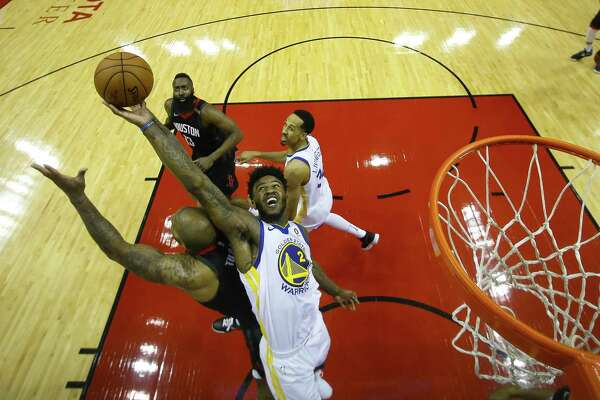 ... Warriors center Jordan Bell (2) tries to grab a rebound over Houston  Rockets forward PJ Tucker (4) during Game 7 of the NBA Western Conference  Finals at ... 6912c1330