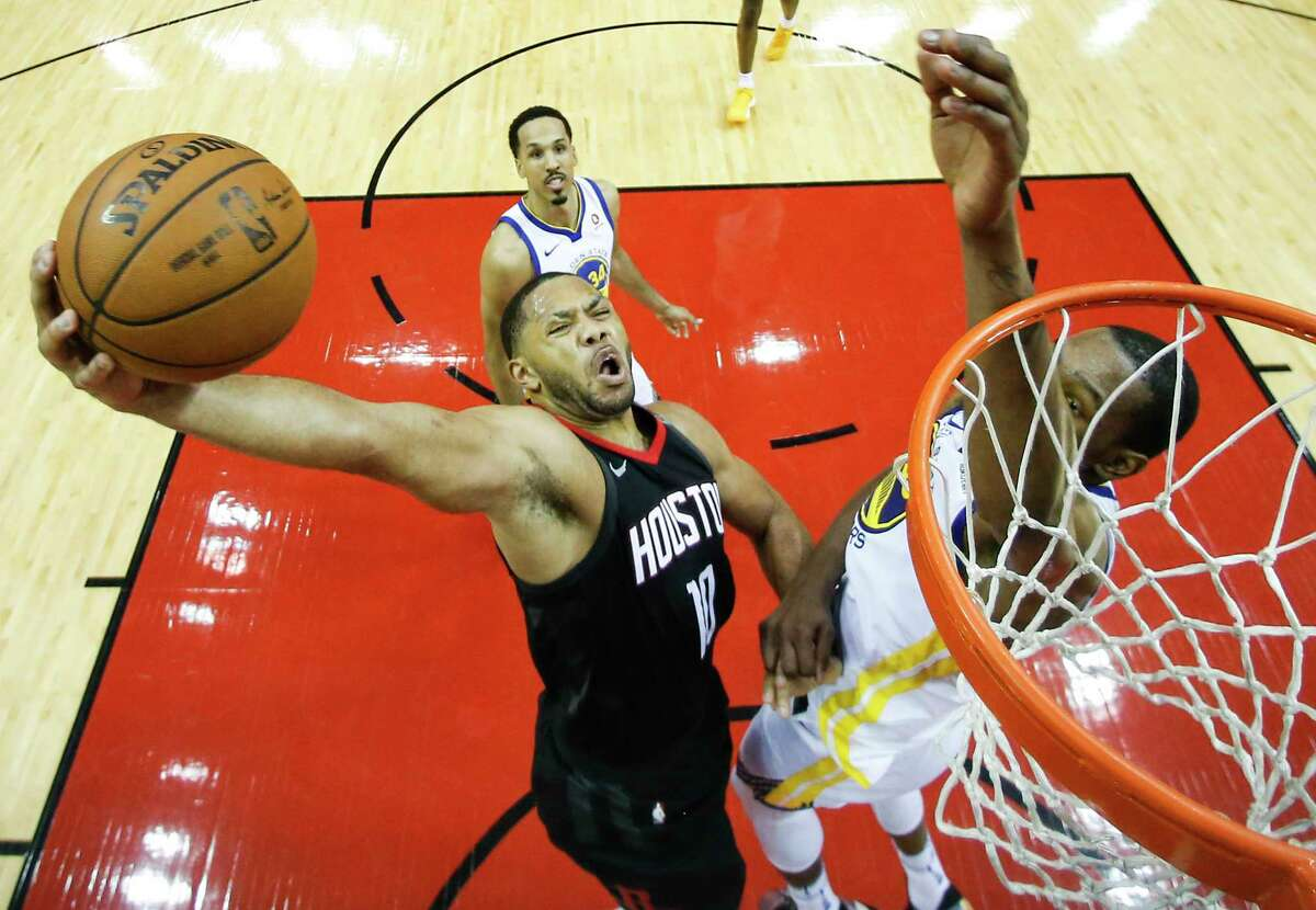 Houston Rockets guard Eric Gordon (10) goes up for a dunk against Golden State Warriors forward Draymond Green (23) during the second half of Game 7 of the NBA Western Conference Finals at Toyota Center on Monday, May 28, 2018, in Houston.