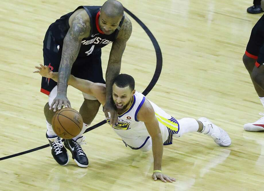 It was all hands on deck in Game 7 as the Rockets' P.J. Tucker (4) and the Warriors' Stephen Curry (30) dive for a loose ball in the second half Monday night. Photo: Karen Warren, Staff / Houston Chronicle / © 2018 Houston Chronicle