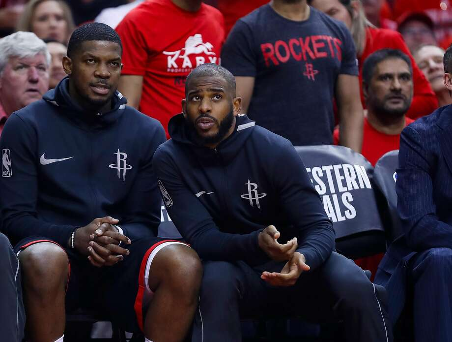 The Rockets' Chris Paul (right), chatting with Joe Johnson, sat out with a hamstring injury. Photo: Brett Coomer / Houston Chronicle