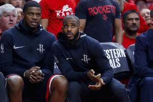Houston Rockets guards Joe Johnson (7) and Chris Paul (3) chat on the bench during Game 7 of the NBA Western Conference Finals at Toyota Center on Monday, May 28, 2018, in Houston. ( Brett Coomer / Houston Chronicle )