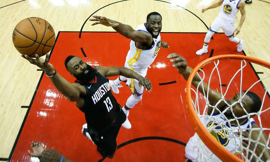 Houston Rockets guard James Harden (13) takes a shot agaisnt Golden State Warriors forwards Draymond Green (23) and Kevin Durant (35) during the second half of Game 7 of the NBA Western Conference Finals at Toyota Center on Monday, May 28, 2018, in Houston. ( Brett Coomer / Houston Chronicle ) Photo: Brett Coomer / Houston Chronicle
