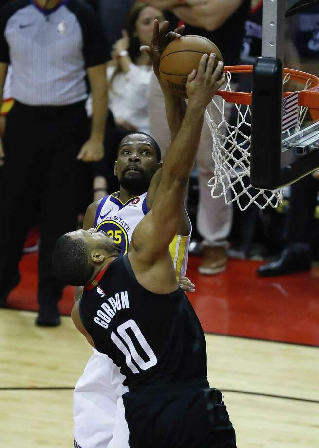 The Warriors' Kevin Durant, rear, blocks a shot by the Rockets' Eric Gordon during the second half of Monday night's game. Photo: Karen Warren, Staff / Houston Chronicle / © 2018 Houston Chronicle