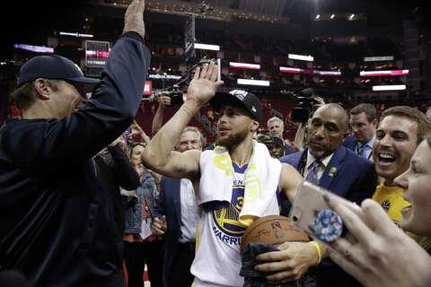 768844c77f67 Stephen Curry high fives Tony Robbins after the Golden State Warriors  defeated the Houston Rockets in