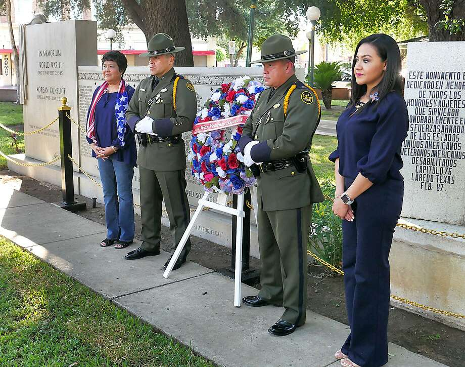 Laura Nañez, Jose de la Garza, Ricardo Rios and Olga Ramirez, from left, honored guest of the Laredo Koreans war Veterans Association during the presentation of a wreath at the World War II Korean Conflict monument at Jarvis Plaza on Monday, as the group hosted their annual Memorial Day ceremony. Photo: Cuate Santos /Laredo Morning Times / Laredo Morning Times