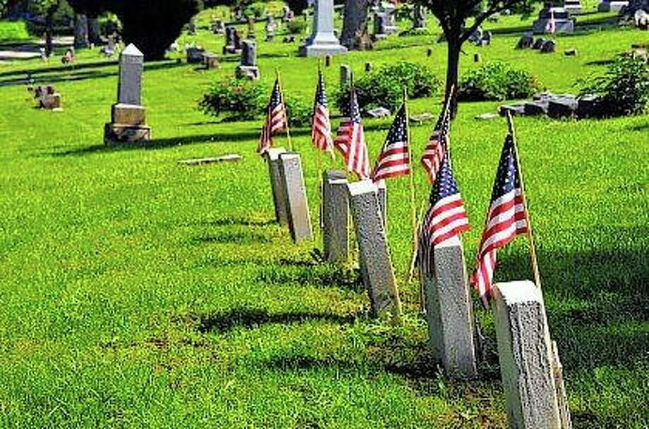 Flags line the graves at Walnut Ridge in Virginia for a Memorial Day program on Monday. Photo:       Robert Daniel | For The Journal-Courier