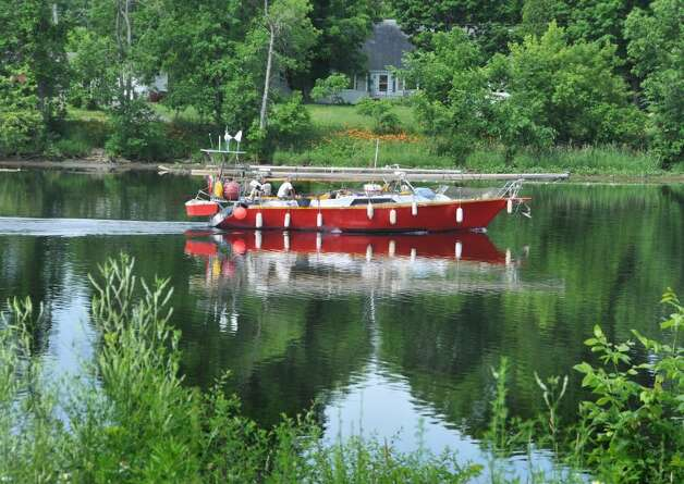 A sailboat motors north on the Champlain Canal in Fort Edward.  (John Carl D'Annibale / Times Union) Photo: John Carl D'Annibale / 00009236A