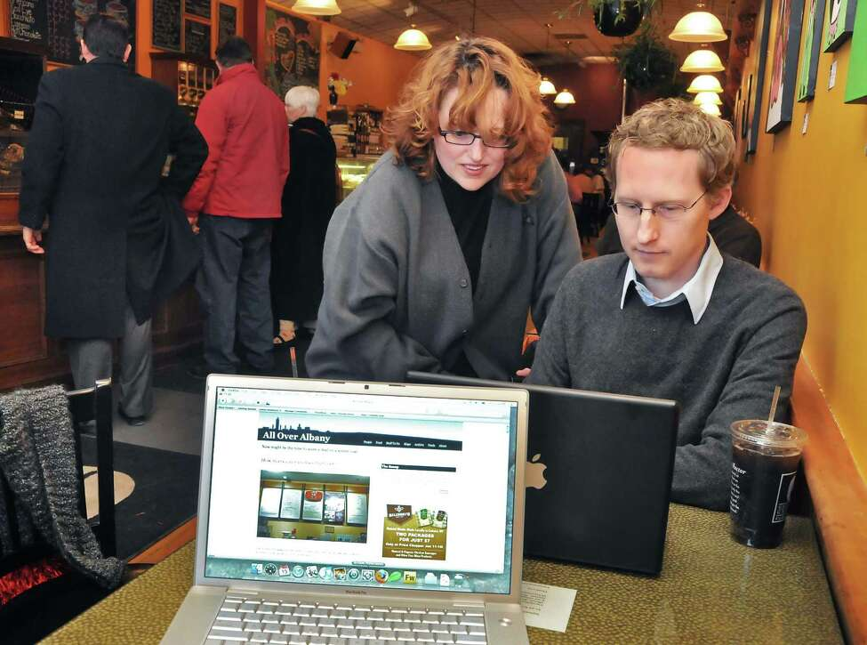 Co-creators of All Over Albany, Mary Darcy, left, and Greg Dahlmann with their laptops at Uncommon Grounds in Albany Friday afternoon January 15, 2010.