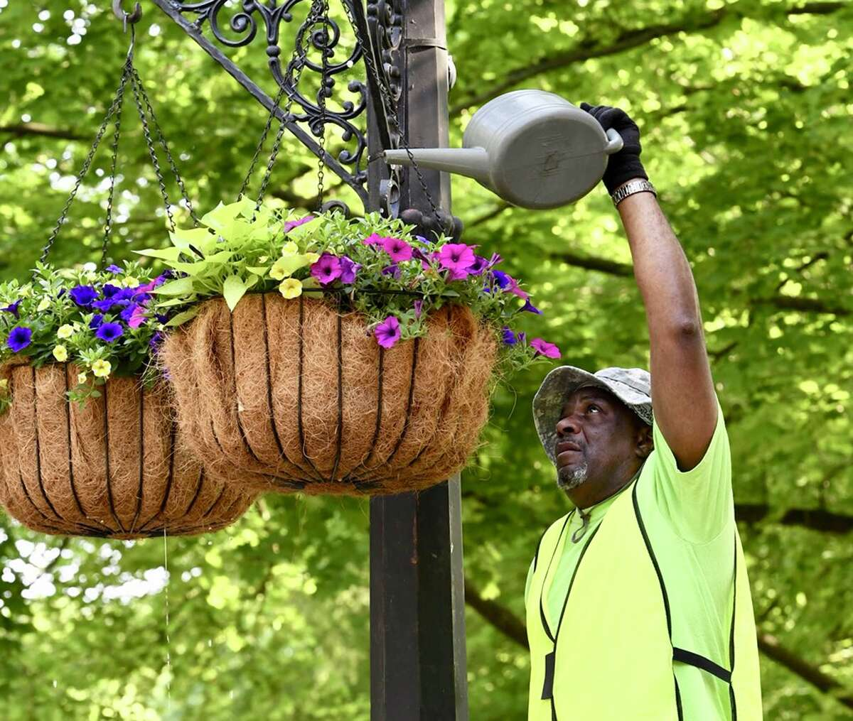 John Fenner waters planters in Washington Park in Troy on Tuesday, May 29, 2018. (Skip Dickstein/Times Union)