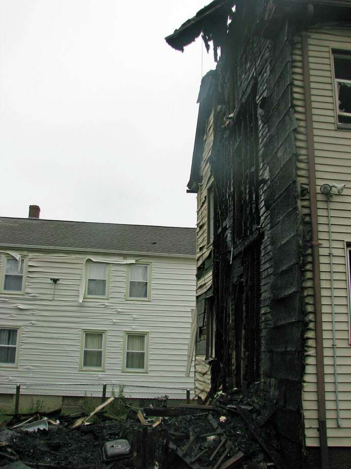 Four Stratford firefighters were injured while battling a blaze that heavily damaged a Canaan Road home early Tuesday on May 29, 2018. Fire Marshal Brian Lampart said about six people were displaced after fire and water damaged their apartments. During the investigation by the fire marshal, it was determined that a charcoal type grill had been used just a few hours before the incident. Witnesses reported seeing the fire in close proximity to the grill's location. Photo: Stratford Fire Department Photo
