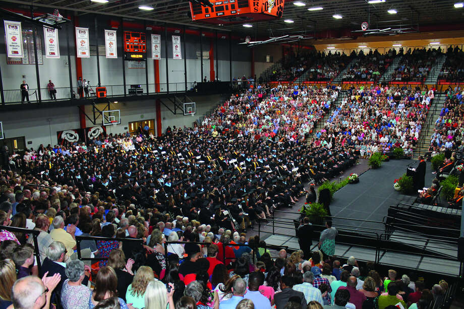 Edwardsville High School Principal Dennis Cramsey, at podium at far right, speaks to the members of the Class of 2018 during Saturday's graduation ceremony.