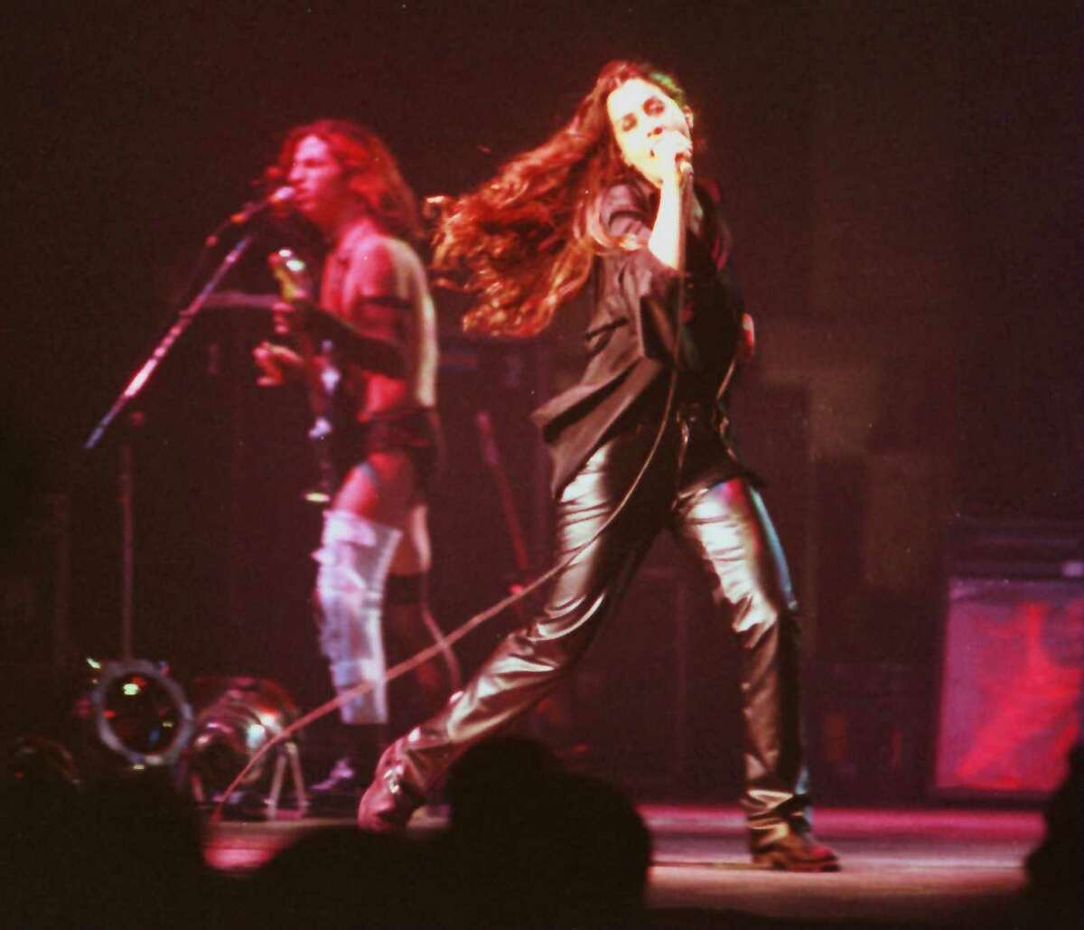 """Alanis Morissette performs at the RPI Fieldhouse in Troy in 1996, the year her breakthrough album """"Jagged Little Pill"""" came out. The album's 25th-anniversary tour bring the singer to the Saratoga Performing Arts Center on Sept. 5, 2021. (Times Union archive)"""