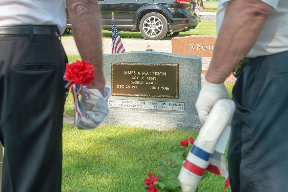 Two veterans honor Jim Matteson who served in World War II, passing in 1994. Photo: Submitted Photo