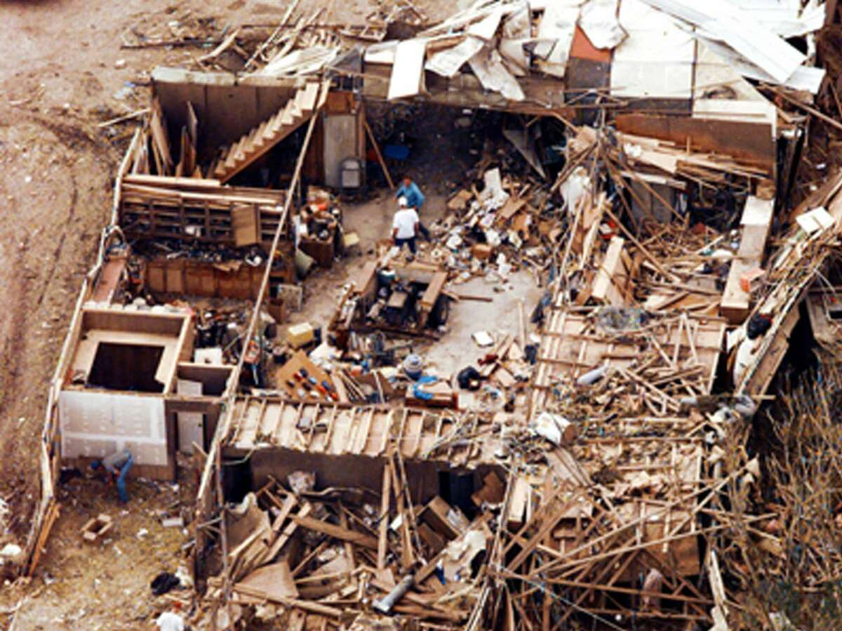 Jarrell, Texas, residents continue search and cleanup efforts in their tornado-ravaged neighborhood, on May 30, 1997. The tornado claimed at least 27 lives, and the damage estimated at $20 million.