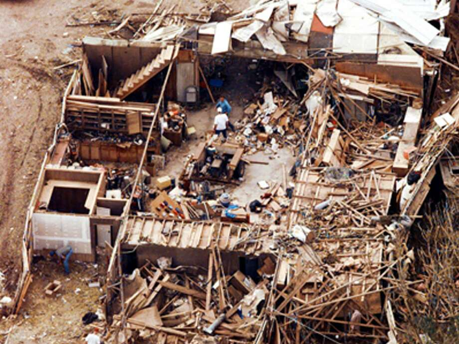 Jarrell, Texas, residents continue search and cleanup efforts in their tornado-ravaged neighborhood, on May 30, 1997. The tornado claimed at least 27 lives, and the damage estimated at $20 million. Photo: ERIC GAY, AP / AP