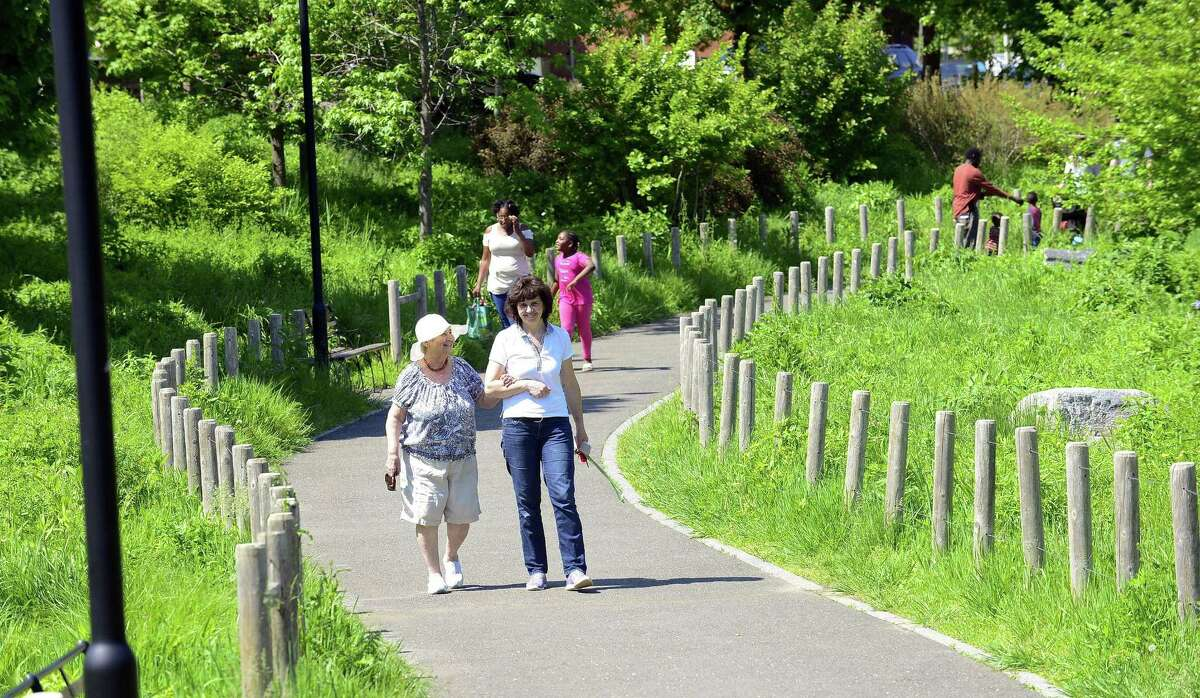 Visitors to Mill River Park enjoy scenic vistas as they take afternoon walks on May 23, 2018 in Stamford, Connecticut.