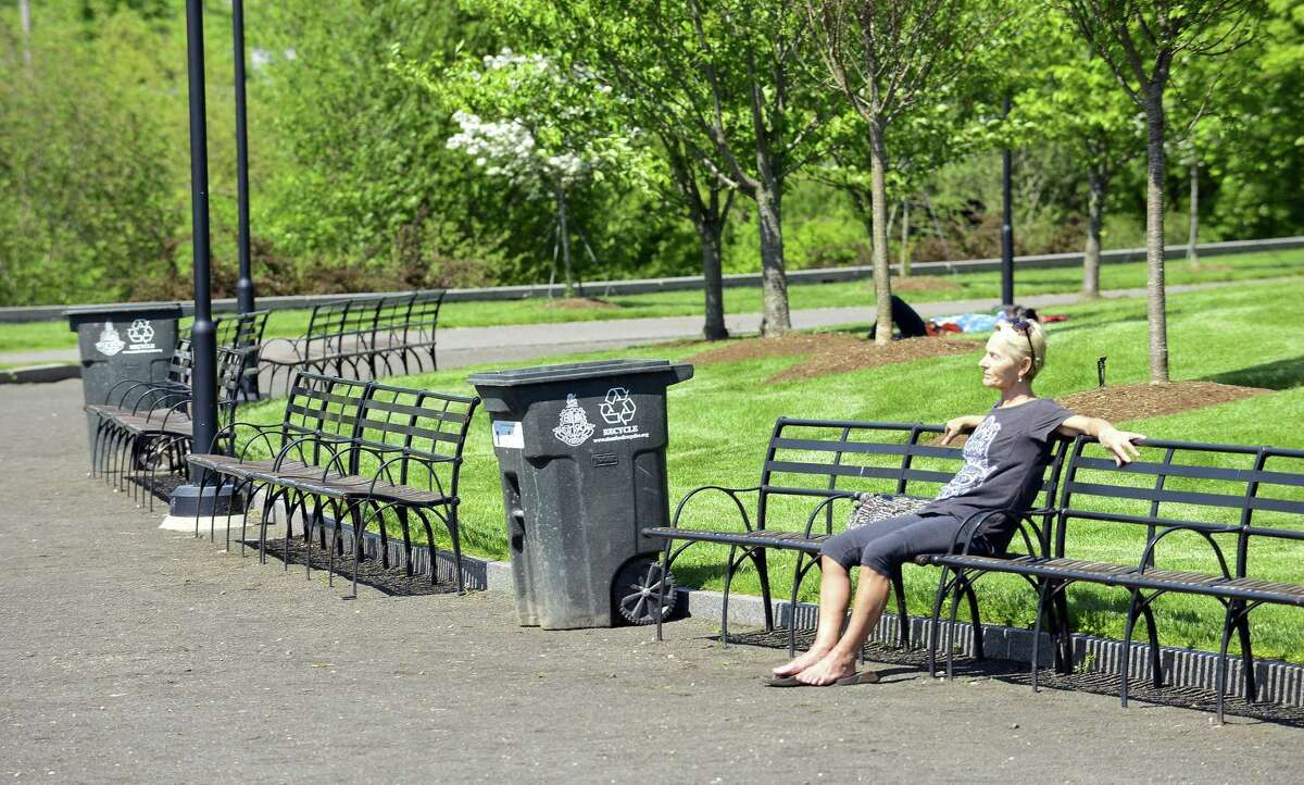 A visitor enjoys the sun and fresh air at Mill River Park on May 23, 2018 in Stamford, Connecticut.