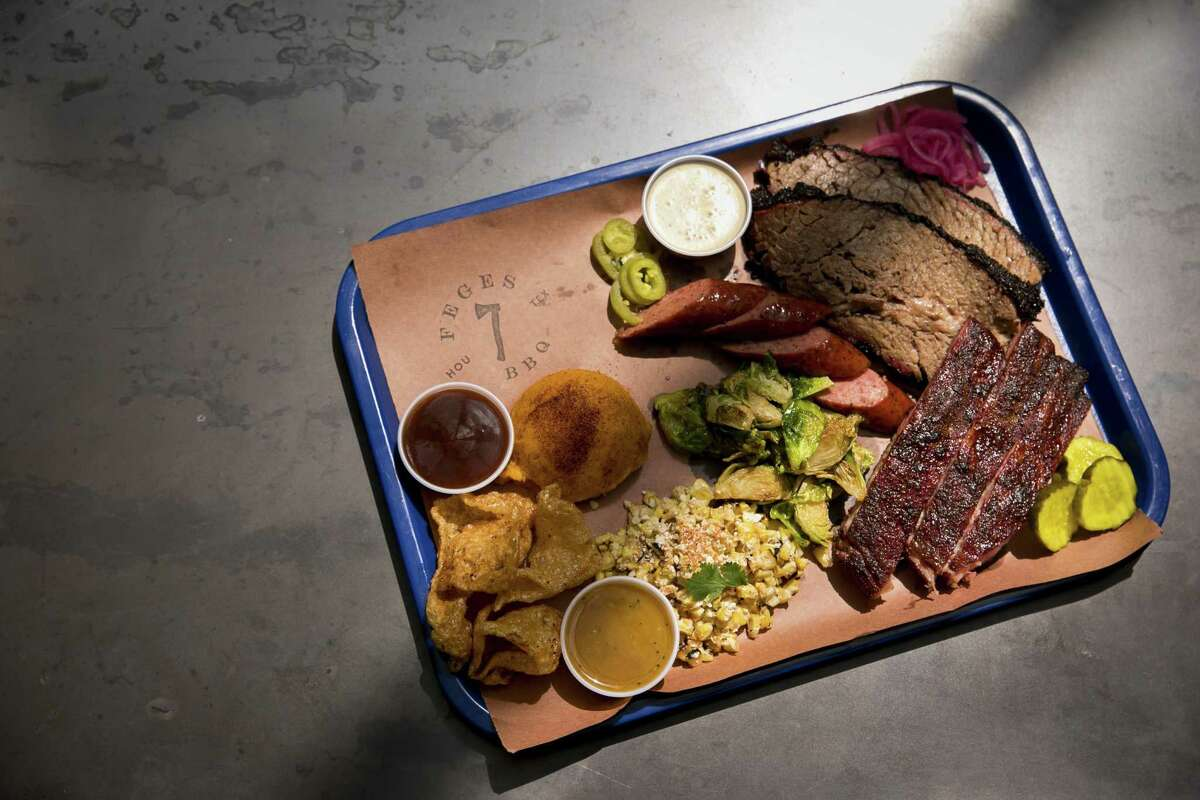 The Texas Trinity (brisket, pork ribs and sausage) with sides at Feges BBQ in Greenway Plaza