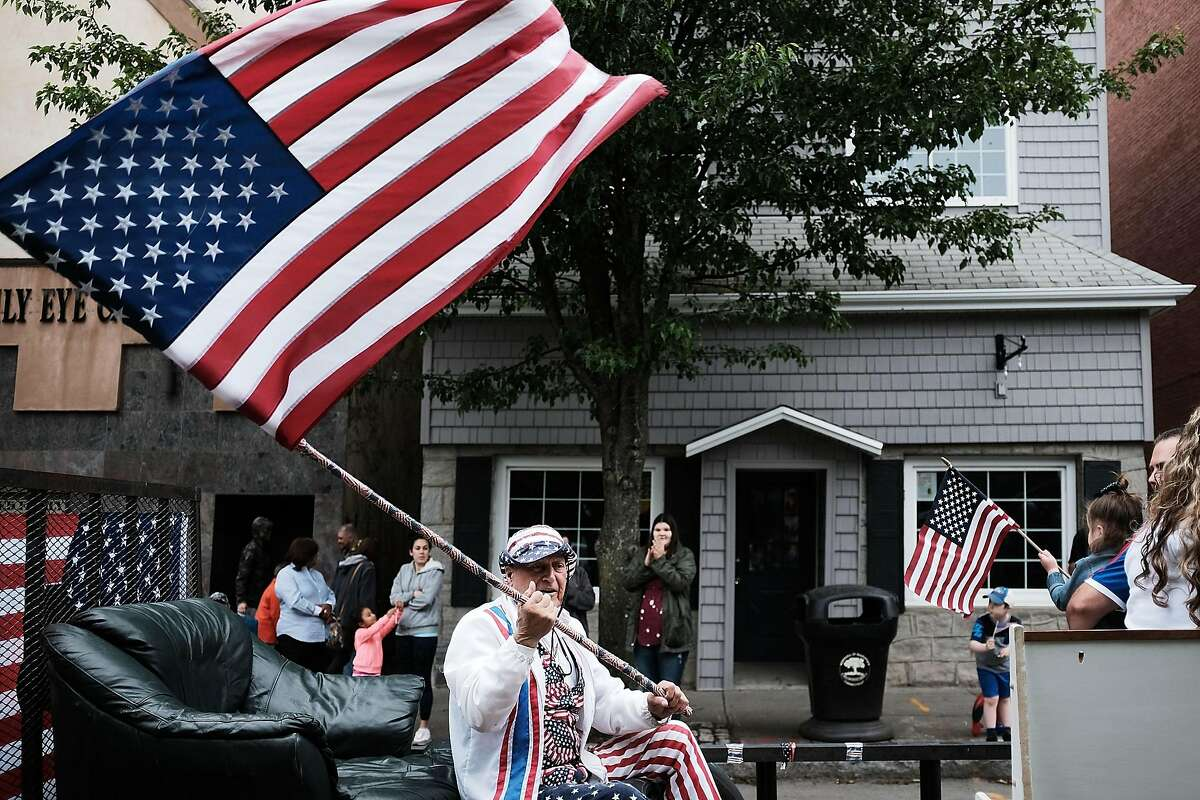 NAUGATUCK, CT - MAY 28: A man waves an American flag during the annual Memorial Day Parade on May 28, 2018 in Naugatuck, Connecticut. Across America, towns and cities will be remembering those who lost their lives while serving in the United States Armed Forces. Memorial Day is a federal holiday in America and has been celebrated since the end of the Civil War. (Photo by Spencer Platt/Getty Images)