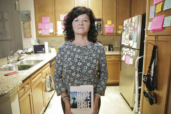 Vickie McGinty's kitchen is covered with notes from Joel Osteen's sermons. She moved to Houston from Kansas to attend Lakewood Church after her marriage fell apart.