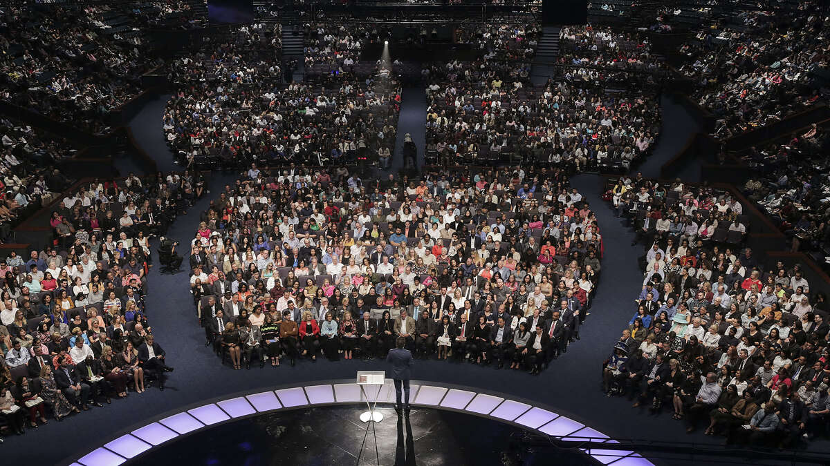 Lakewood Church pastor Joel Osteen speaks to thousands of people gathered to hear his sermon.