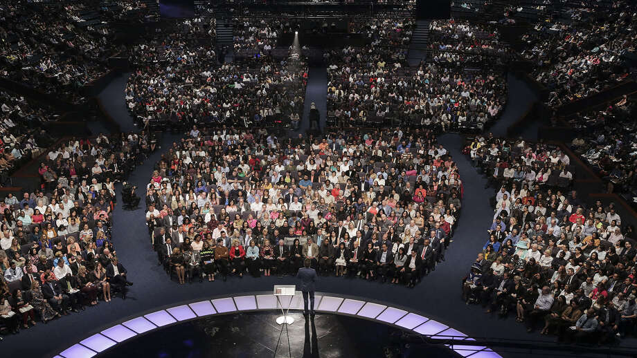 Lakewood Church pastor Joel Osteen speaks to thousands of people gathered to hear his sermon. Photo: Elizabeth Conley