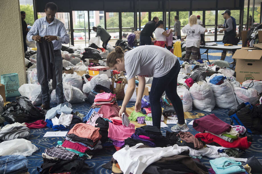 Volunteers sort through donations delivered to Lakewood Church. After the storm, the church sheltered Hurricane Harvey evacuees. Photo: Marie D. De Jesús