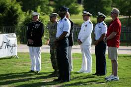 The township's annual Memorial Day event is scheduled to begin at 5 p.m., Sunday, May 26, at Town Green Park, located at 2099 Lake Robbins Drive, said Nick Wolda, a spokesman for the township and president of Visit The Woodlands. The evening of celebration will include patriotic speeches, remembrance of those who have died while in the many different branches of the armed services, musical entertainment, kids activities and a fireworks extravaganza. In this file photograph, retired and active-duty members of the military listen to the keynote address by Retired U.S. Army Col. Randall M. Pais during the Memorial Day Festival on Sunday, May 27, 2018, at Town Green Park in The Woodlands.