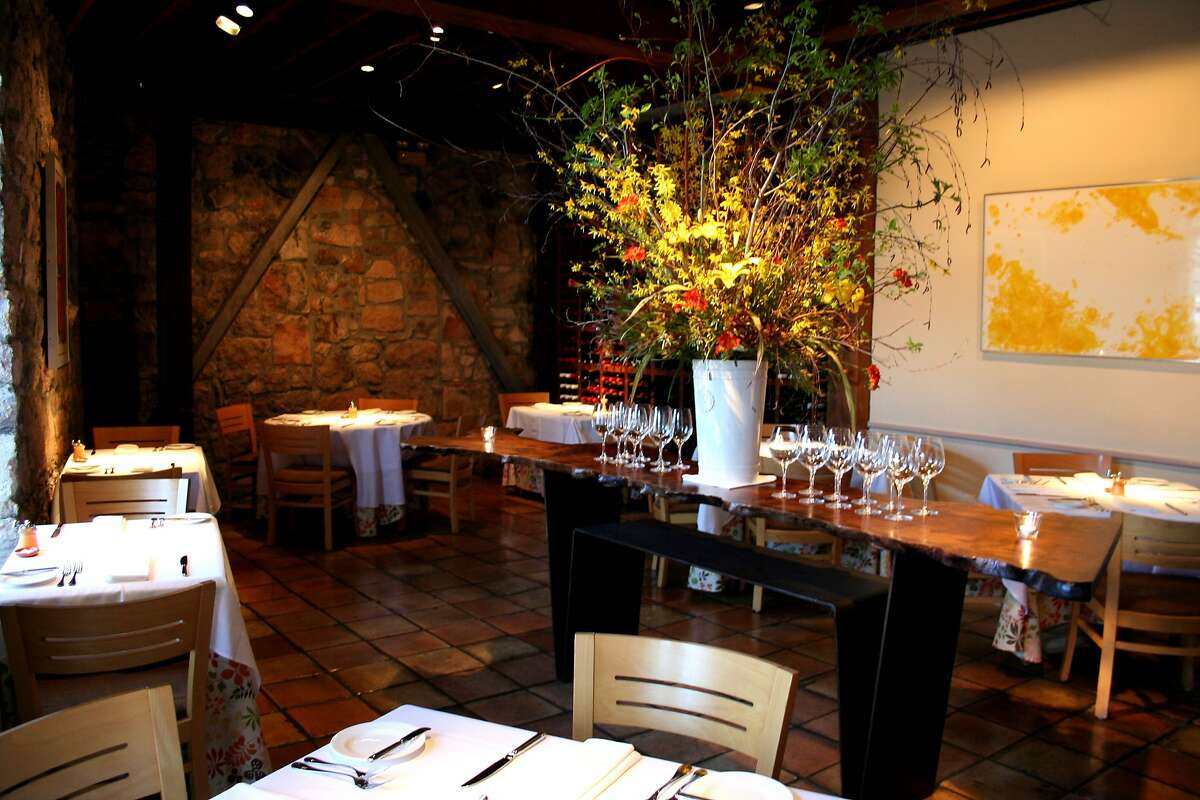 The dining room and wine-service table of Terra restaurant in St. Helena, Calif.
