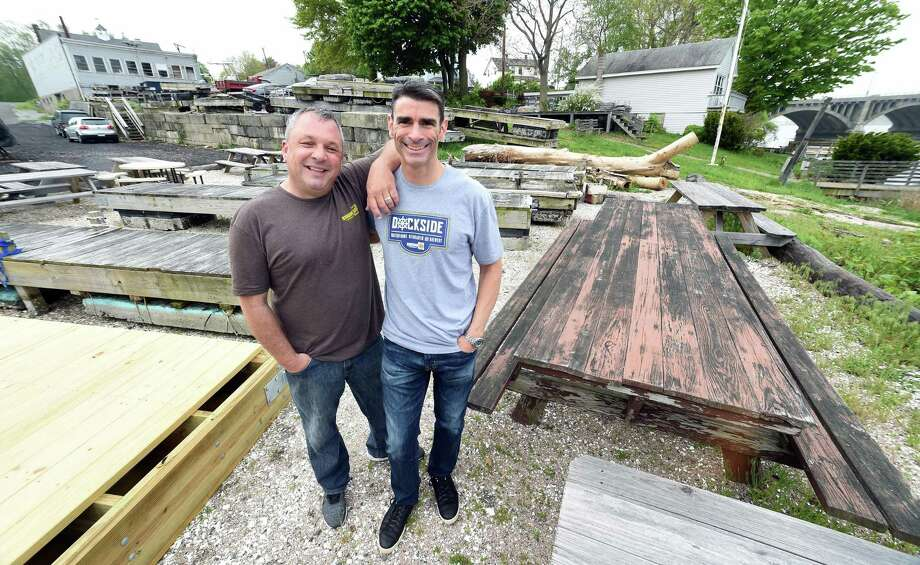 Dan Bagley (left) and Bob Chicoine, photographed on May 15, 2018 have plans to build Dockside, a waterfront biergarten and brewery, at this location on Bridgeport Ave. in Milford. Photo: Arnold Gold / Connecticut Hearst Media / New Haven Register