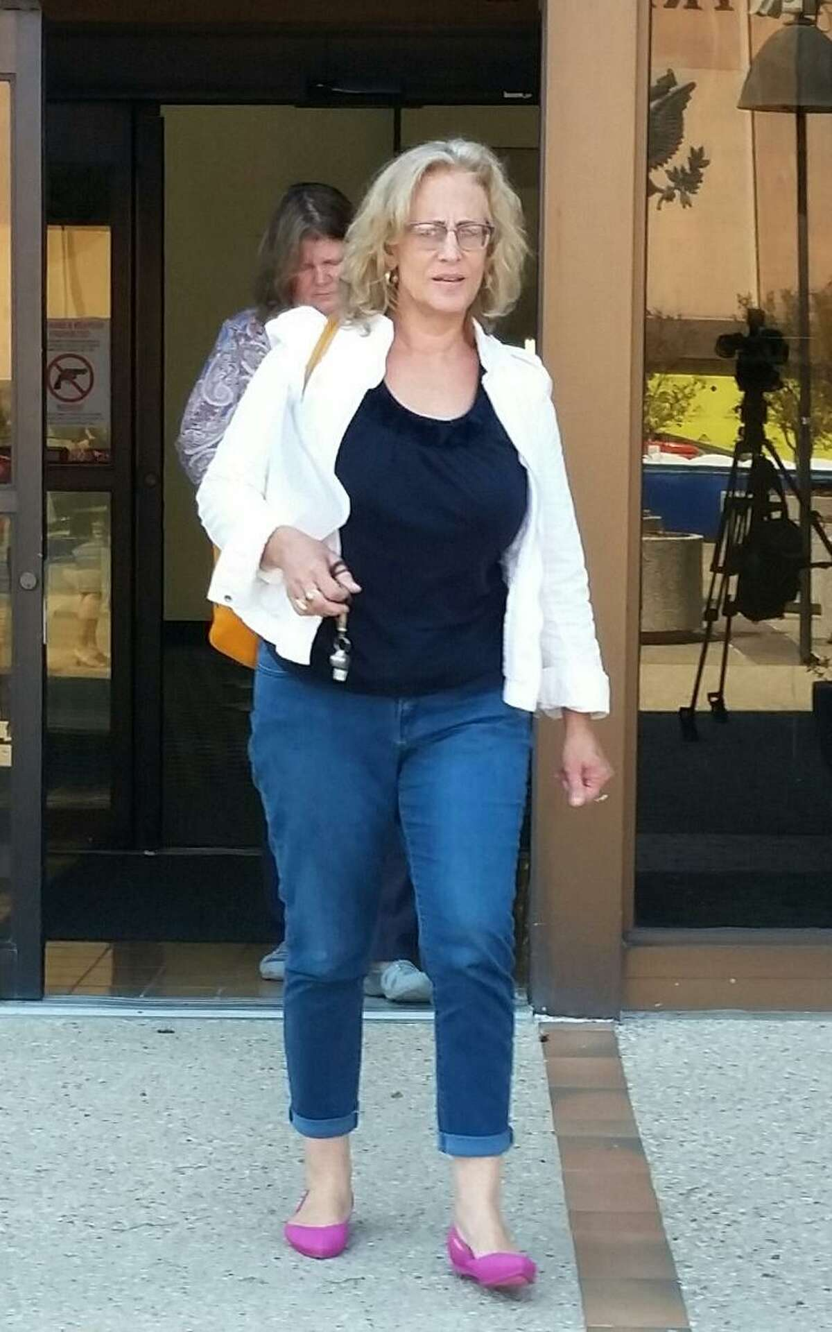 """Jodi Mann, who describes herself as """"Conspiracy Granny,"""" leaves San Antonio's federal courthouse on Tuesday, May, 29, 2018, after her boyfriend, Robert Mikell Ussery, was denied bail. Ussery was arrested on a gun charge in the aftermath of the pair's confrontation in March with the pastor of the First Baptist Church of Sutherland Springs. Ussery and Mann claim the November massacre, in which 26 churchgoers were killed by a gunman, is a """"government hoax."""""""